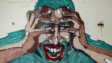 muurschildering van persoon die stress ervaart